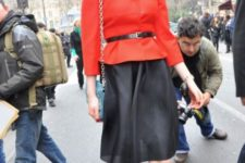 With black knee-length skirt, chain strap bag and ankle strap shoes