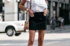 With black mini skirt, beige mini bag and sandals