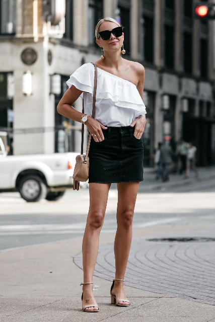 With black mini skirt, beige mini bag and sandals