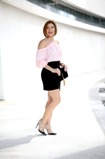 With black mini skirt, clutch and embellished shoes