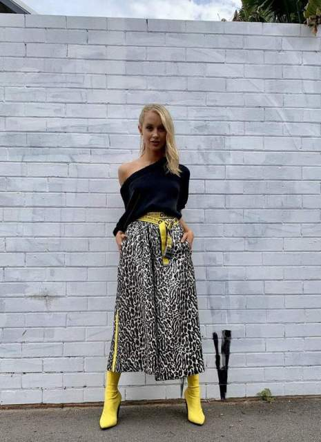With black one shoulder blouse, yellow belt and yellow boots