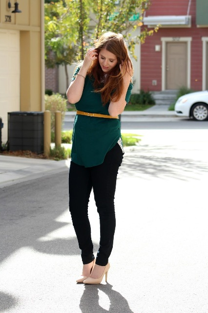 With black pants and beige pumps