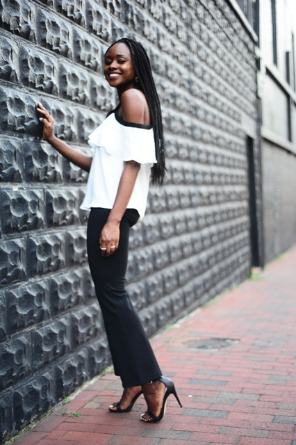 With black pants and black high heels