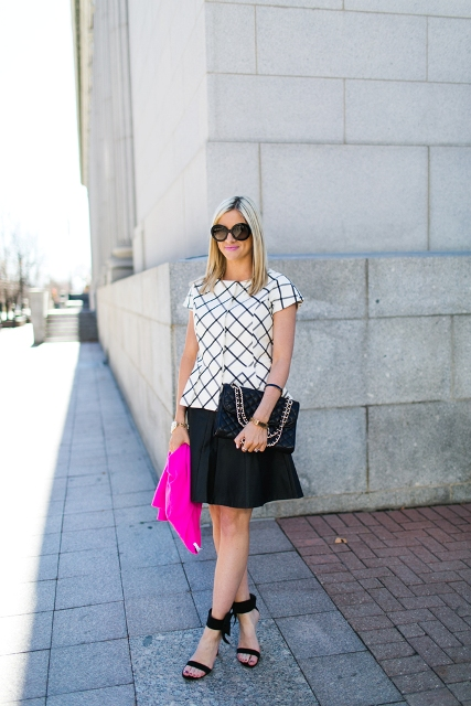 With black skater skirt, black bag and high heels