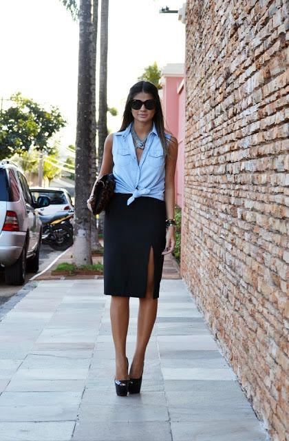 With black slit skirt, black clutch and black platform shoes