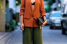 With black top, brown long blazer, black shoes and small bag