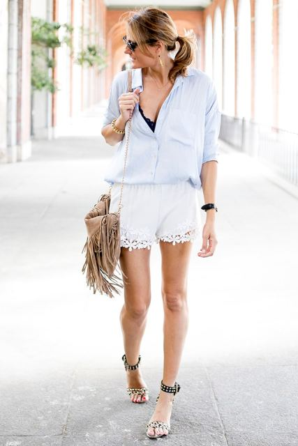 With black top, light blue shirt, fringe bag and ankle strap high heels