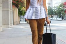 With brown cuffed pants, black tote and lace up high heels