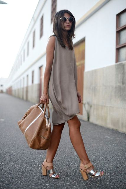 With brown leather tote bag and metallic high heels