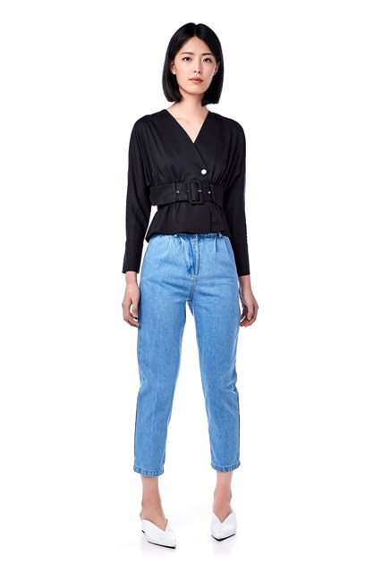 With cropped jeans and white mules