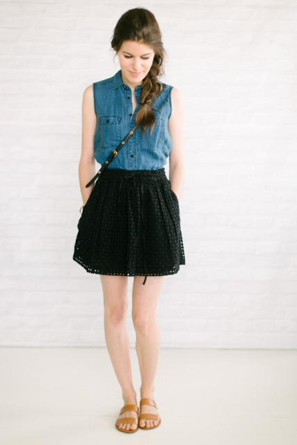 With crossbody bag, brown flat shoes and black skater skirt