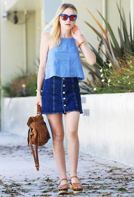 With denim mini skirt, brown mini backpack and sandals
