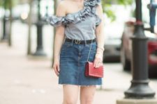 With denim mini skirt, red mini bag and black ankle strap sandals