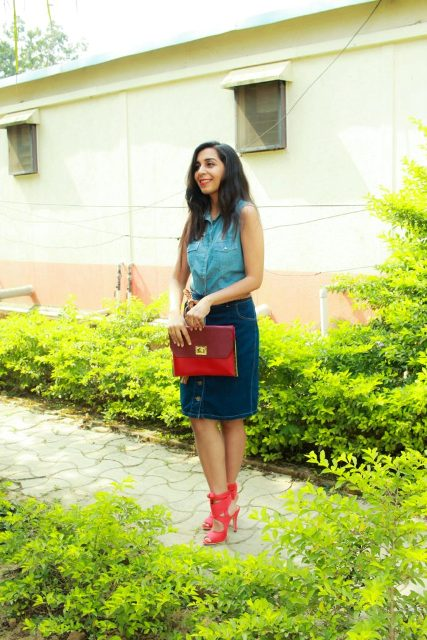 With denim pencil skirt, red clutch and red lace up sandals