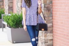 With distressed jeans, black bag and black shoes
