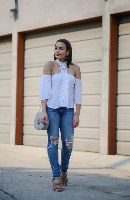 With distressed jeans, gray chain strap bag and sandals
