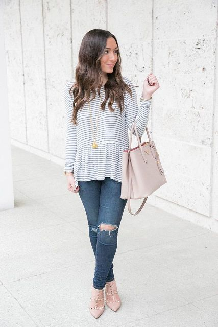 With distressed jeans, light pink bag and high heels