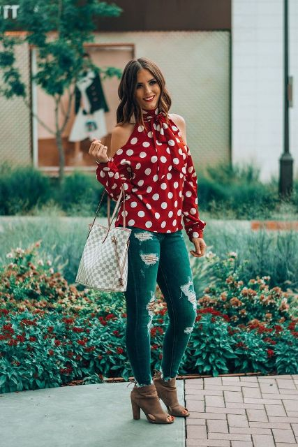 With distressed jeans, printed tote bag and cutout shoes