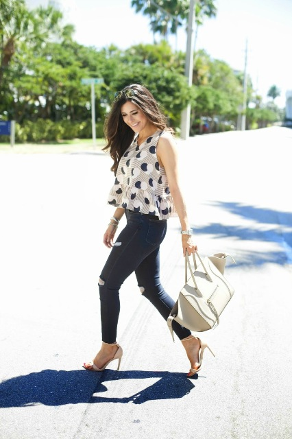 With distressed pants, high heels and white tote bag