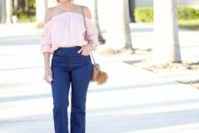 With flare jeans, beige bag and high heels