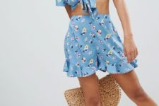 With floral crop top, black lace up shoes and straw bag