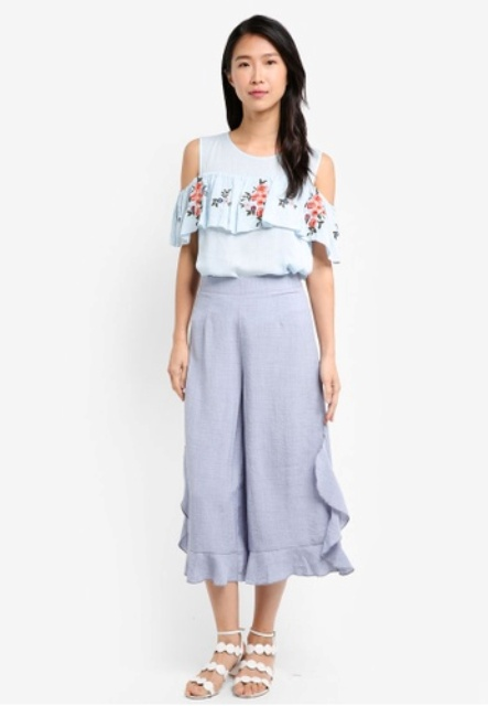 With floral off the shoulder top and white flat sandals
