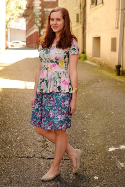 With floral skirt and beige flats