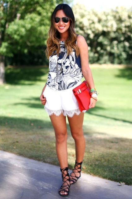 With floral top, red clutch and lace up sandals