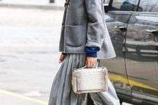 With gray jacket, gray heels and bag