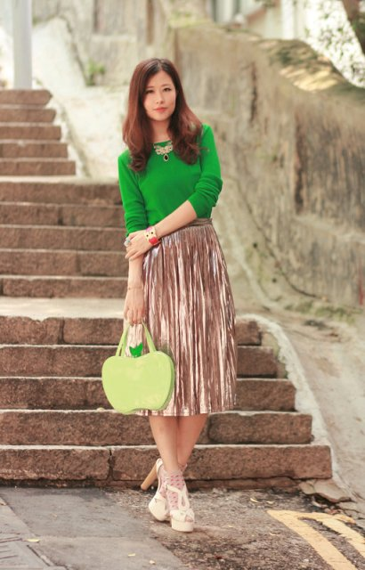 With green shirt, metallic pleated skirt and white platform sandals