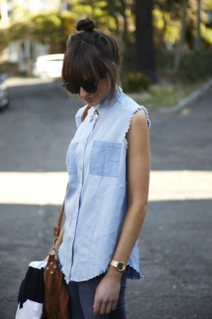 With jeans and brown bag