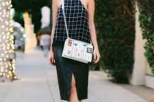 With leather skirt, printed crossbody bag and white shoes