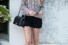 With leopard blouse, black chain strap bag and black sneakers