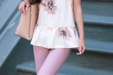 With lilac pants, beige tote bag and yellow pumps