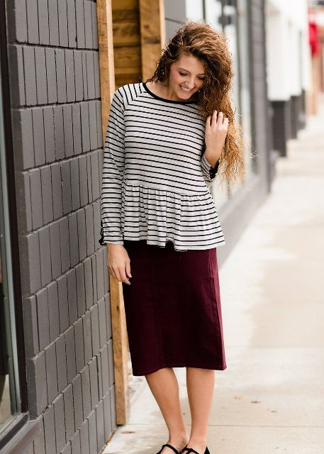 With marsala midi skirt and black sandals