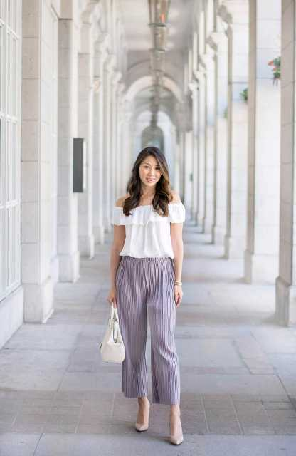 With off the shoulder top, white bag and beige pumps