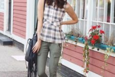 With olive green pants, hat, fringe bag and gray suede boots