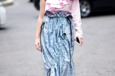 With pale pink one shoulder ruffled blouse and black platform shoes