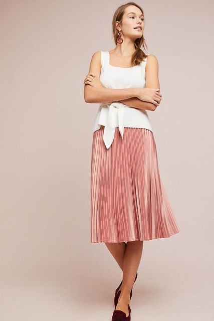 With pale pink pleated midi skirt and marsala flat shoes