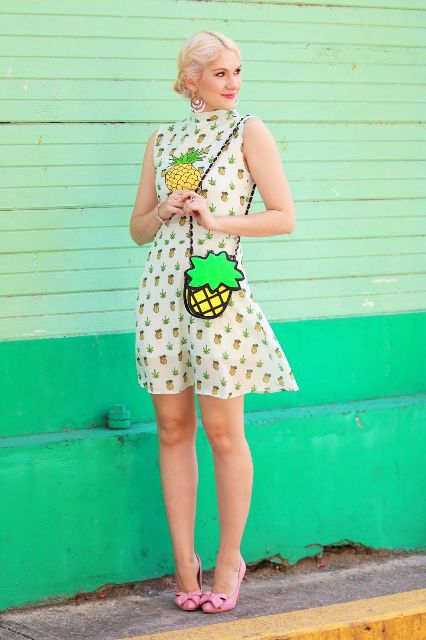 With pineapple printed dress and pale pink flats