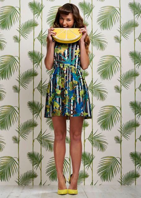 With printed mini dress and yellow pumps