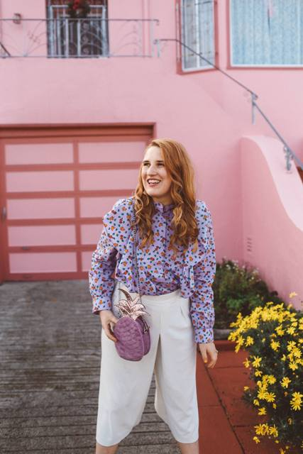 With printed ruffled blouse and white culottes