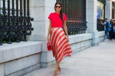 With red shirt, red small bag and red high heels