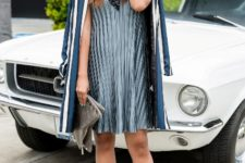 With silver pumps, striped blazer and gray clutch