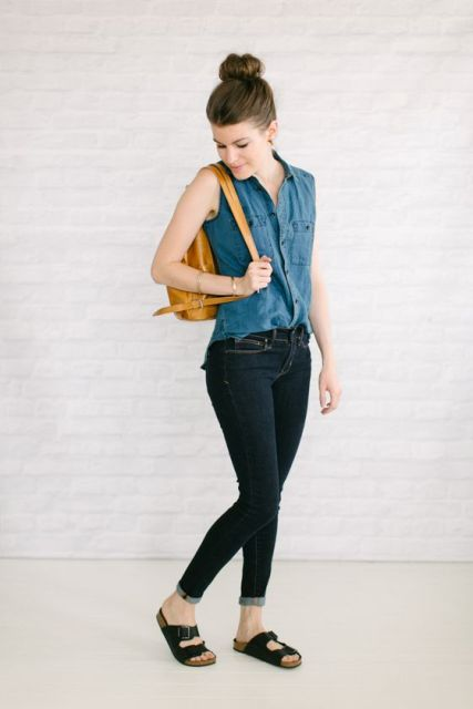 With skinny jeans, brown backpack and black flat sandals