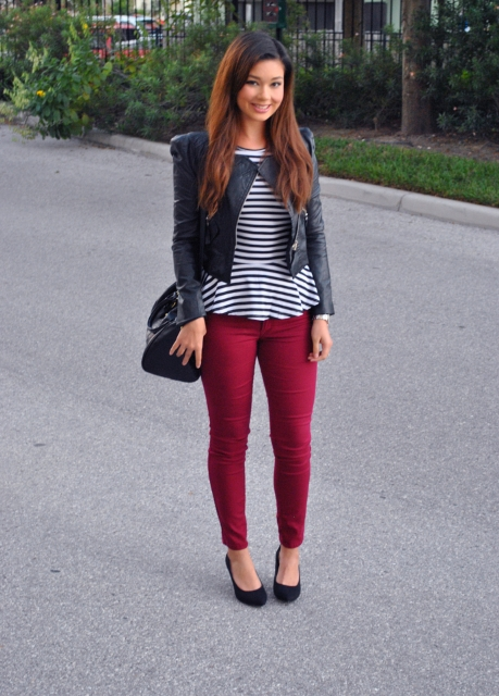 With skinny pants, leather jacket, black bag and black pumps