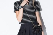 With striped shirt and mini bag