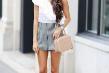 With striped shorts, beige bag and beige sandals