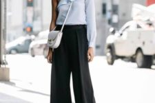 With white bag, black culottes and black ankle strap shoes
