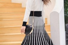 With white blouse and heart shaped bag